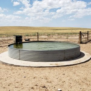 One bottomless tank with concrete apron in center of the section serves all four pastures