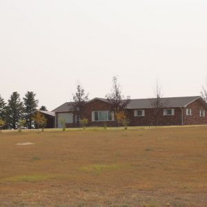#10 - View from county road to residence