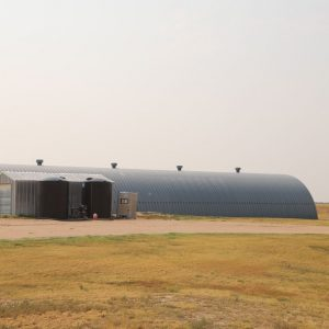 Parcel #10 - Quonset shed with adjacent steel storage shed